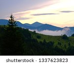 the sunset and evening fog in... | Shutterstock . vector #1337623823