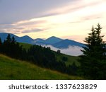 the sunset and evening fog in... | Shutterstock . vector #1337623829