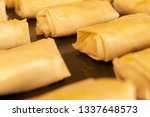 rows of raw puff pastry cheese... | Shutterstock . vector #1337648573