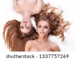 close up. two young women lying ... | Shutterstock . vector #1337757269
