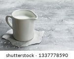 milk in a cup on paper. on a... | Shutterstock . vector #1337778590
