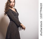 beautiful girl in stylish dress ... | Shutterstock . vector #1337794610
