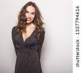 beautiful girl in stylish dress ... | Shutterstock . vector #1337794616