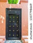 ancient wooden door with carved ... | Shutterstock . vector #1337798669