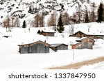 log cabins covered by snow in... | Shutterstock . vector #1337847950