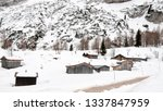 log cabins covered by snow in... | Shutterstock . vector #1337847959