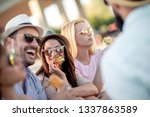 group of young people eating... | Shutterstock . vector #1337863589
