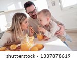 family making juice in their... | Shutterstock . vector #1337878619