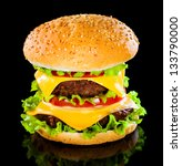 Tasty and appetizing hamburger on a darkly background - stock photo