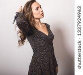 beautiful girl in stylish dress ... | Shutterstock . vector #1337924963