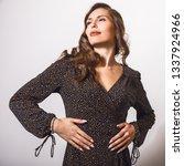 beautiful girl in stylish dress ... | Shutterstock . vector #1337924966