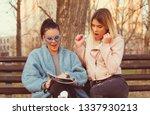 Stock photo two young girl reading magazine and newspaper surprise and smiling news and horoscope friend time 1337930213