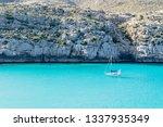 sailboat at blue water beach | Shutterstock . vector #1337935349