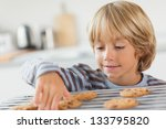 boy taking a cookie in the... | Shutterstock . vector #133795820