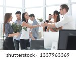 happy business team in new... | Shutterstock . vector #1337963369