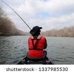 A Man In A Drysuit Casting A...