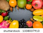 exotic tropical fruits on black ... | Shutterstock . vector #1338037913