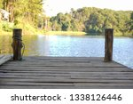wooden waterfront in forest ... | Shutterstock . vector #1338126446