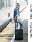 woman with suitcase on the... | Shutterstock . vector #133813094