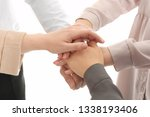 group of people holding their... | Shutterstock . vector #1338193406