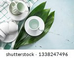 tea cups with saucers on light... | Shutterstock . vector #1338247496