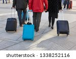 travelers walking with luggage... | Shutterstock . vector #1338252116