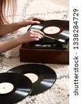 young woman with old record... | Shutterstock . vector #1338284729