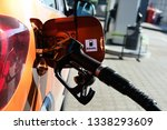 pumping gasoline fuel in orange ... | Shutterstock . vector #1338293609