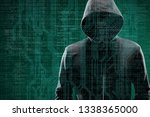 computer hacker in mask and... | Shutterstock . vector #1338365000