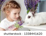 little girl playing with real...   Shutterstock . vector #1338441620