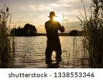 angler catching the fish during ... | Shutterstock . vector #1338553346