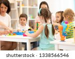 teacher and assistant playing... | Shutterstock . vector #1338566546