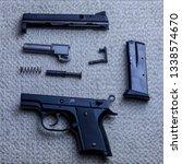 czech disassembled small gun on ...   Shutterstock . vector #1338574670