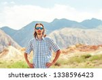 the guy standing on a... | Shutterstock . vector #1338596423