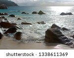 rough waves at anse lazio ... | Shutterstock . vector #1338611369