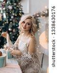 charming blonde woman opens... | Shutterstock . vector #1338630176