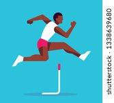 black athlete jumping in hurdle ... | Shutterstock .eps vector #1338639680