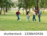 happy multicultural group of... | Shutterstock . vector #1338643436
