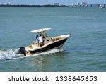 dark blue motor boat with white ... | Shutterstock . vector #1338645653