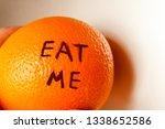 eat me inscription on orange on ... | Shutterstock . vector #1338652586
