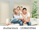 beautiful smiling family in... | Shutterstock . vector #1338653966