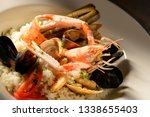 rice with seafood on a plate in ... | Shutterstock . vector #1338655403