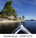 kayak on a northern lake with... | Shutterstock . vector #133871294