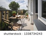 leisure area on a balcony in a... | Shutterstock . vector #1338734243