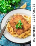 a piece of fried cod with fries ... | Shutterstock . vector #1338736793