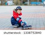 little school kid boy skating...   Shutterstock . vector #1338752840
