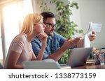 worried young couple checking... | Shutterstock . vector #1338773159