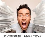 business man with heap of papers | Shutterstock . vector #1338774923
