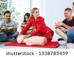 instructor demonstrating cpr on ... | Shutterstock . vector #1338785459