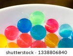 water coloured gel balls on a... | Shutterstock . vector #1338806840